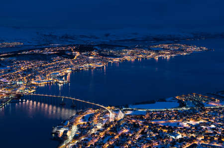 Arctic city of Tromso with bridge and famous cathedal. photo