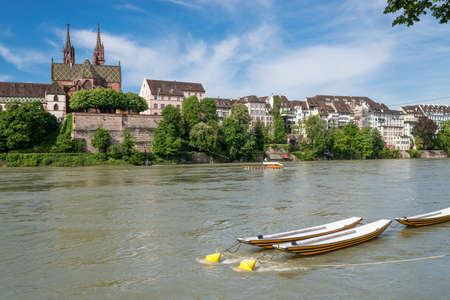 Tranquil scene on the Rhine boarder with a nice view up to the Basel cathedral. Stock Photo