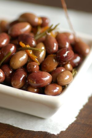 bowl of olives marinated in rosemary and olive oil photo