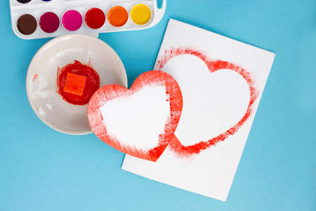 happy valentines day, girls hands make a greeting card for the holiday, instruction, step by step, DYI step seven two ready-made openings for congratulations in the form of a heart