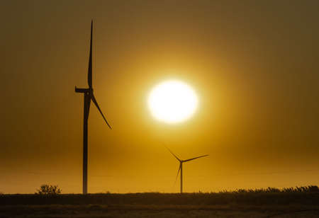wind generators on the background of the sky without clouds at sunset near the Lemurian lake, Ukraine Banco de Imagens