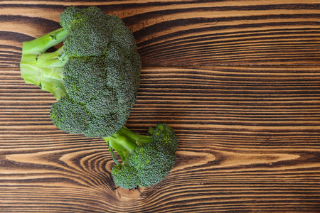 Broccoli on wooden background. Top view