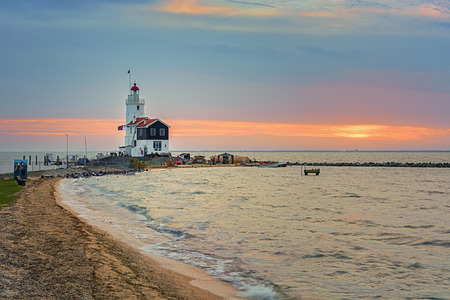 """marken: The Paard van Marken lighthouse, translated as """"Horse of Marken"""", is a famous Dutch lighthouse located at the Ijsselmeer at the village called Marken."""