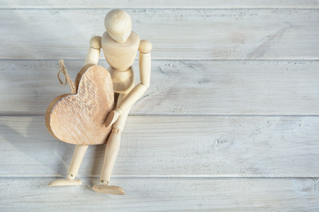 immobility: The dummy sits on the board and holding a wooden heart.