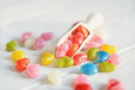 measuring spoon: Colored pills in the kitchen measuring spoon. Stock Photo
