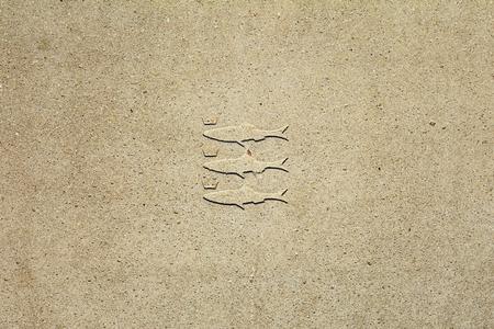 The weapon of Scheveningen in a concrete sidewalk tile. Imagens