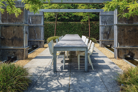 tiled stove: Appeltern, The Netherlands, July 22, 2015: The Gardens of Appeltern is the inspiration garden park in the Netherlands. In this picture trendy a terrace  with trendy garden furniture between concrete fences.