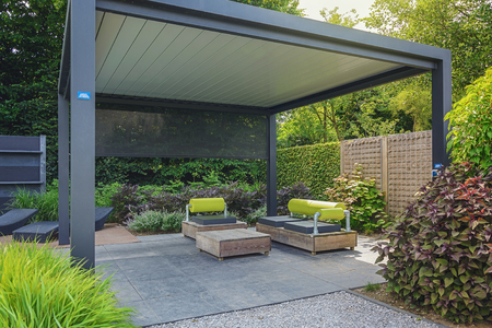 garden furniture: Appeltern, The Netherlands, July 22, 2015: The Gardens of Appeltern is the inspiration garden park in the Netherlands. In this picture trendy sunloungers and overhang with trendy garden furniture. Editorial