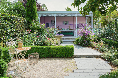 Appeltern, The Netherlands, July 22, 2015: The Gardens of Appeltern is the inspiration garden park in the Netherlands. In this picture a patio painted in pastel tones and furnished as a living room.