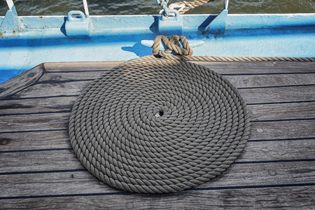 coiled rope: On the deck a neatly coiled rope ship Stock Photo