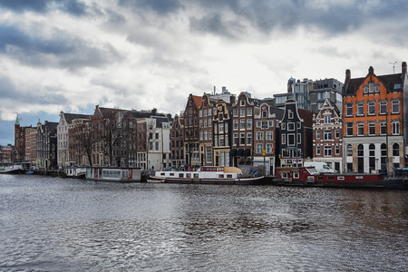 canal houses: Amsterdam, Netherlands - February 7, 2016: a look at the canal houses along the Amstel River in Amsterdam city center.