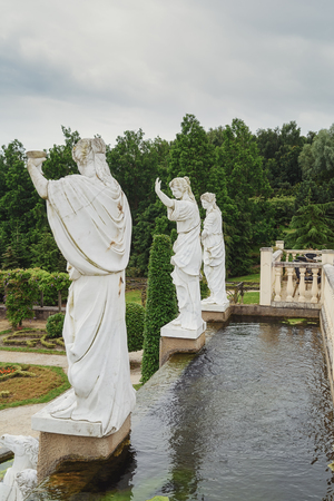 mondo: Landgraaf, The Netherlands - July 12, 2016: Parc Mondo Verde picture of a pond with on the end the back of a four Roman statutes.