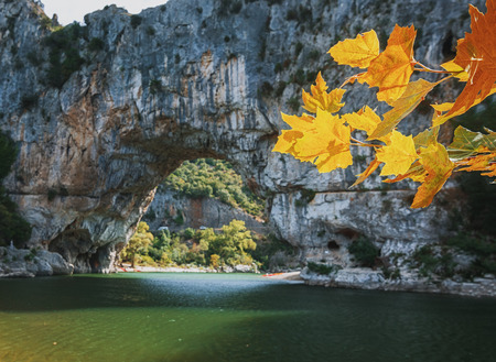 The Pont dArc is a large natural bridge, located in the Ardeche department in the south of Franc. The arch, carved out by the Ardeche River, is 60 m wide and 54 m high.