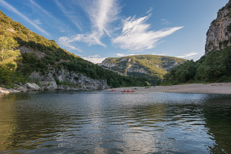 The beach near the Pont dArc, a large natural bridge, located in the Ardeche d? ? partment in the south of Franc.