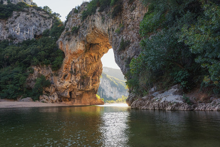 natural bridge: The Pont dArc is a large natural bridge, located in the Ardeche department in the south of Franc. The arch, carved out by the Ardeche River, is 60 m wide and 54 m high.