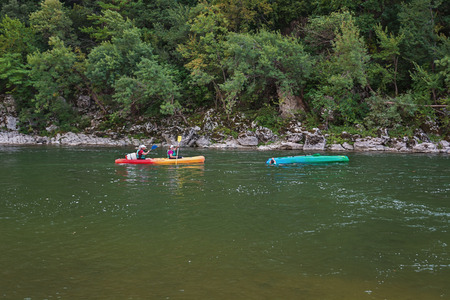 inverted: Pont d'Arc, France – September 19, 2016: Kayakers on the river Ardeche in France.