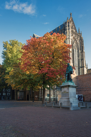 Utrecht, Netherlands - October 23, 2016: The back of the Cathedral Church in front with a statute of John of Nassau.