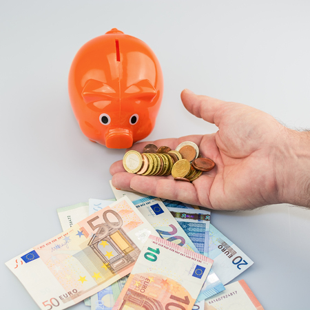 Piggy bank feeded with Euro banknotes and coins.