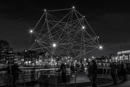 Amsterdam, Netherlands - December 18, 2015: Light Festival Amsterdam, a diamond of light floating on the river The Amstel in Amsterdam Editorial