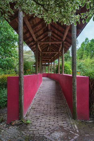 chinese garden: Landgraaf, Netherlands - July 12, 2016: Chinese garden which is crossed by a covered walkway stand with walls symbolizing the Great Wall. Editorial