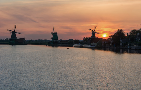 The Zaanse Schans with its windmills, typical green wooden houses, bridges and ditches. Stock Photo