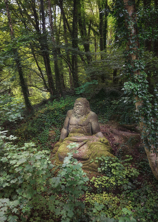 Landgraaf, The Netherlands - July 12, 2016: Statue of Zeus at the Folies forest of Parc Mondo Verde.