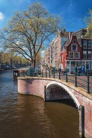 old center: Amsterdam, Netherlands, April 10, 2016: The bridge over the canal Reguliersgracht in the old center of Amsterdam. Editorial