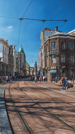 Amsterdam, Netherlands, April 10, 2016: Reguliersbreestraat in the old center of Amsterdam with in the background the Munttoren.