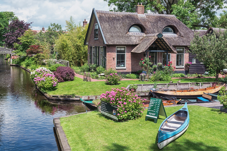 Giethoorn, The Netherlands - June 29, 2016: A thatched cottage that looks like a cat. Editorial