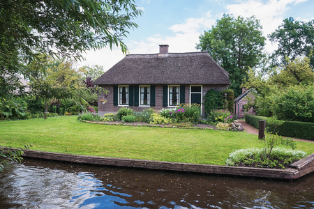 Old ranch canal in a small Dutch town of Giethoorn. Stock Photo