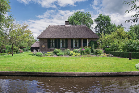 felled: Old ranch canal in a small Dutch town of Giethoorn. Stock Photo