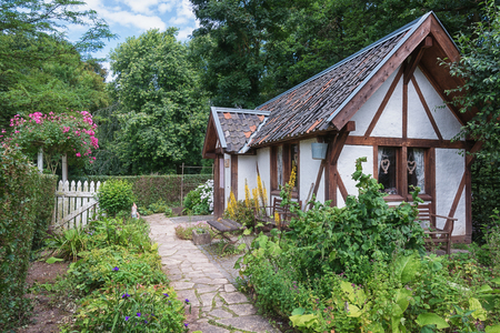 Image of a cottage in the English garden of Park Mondo Verde. Stock Photo