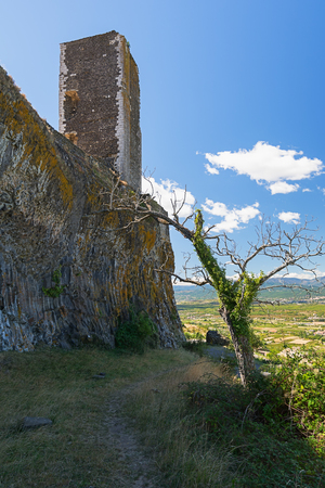 Basalt tower of castle ruin in Mirabel, Ardeche mountains, France Stock Photo