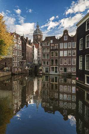The canal houses along the junction of the canals Oudezijds Voorburgwal and Oudezijds Achterburgwal in the old center of Amsterdam Editorial