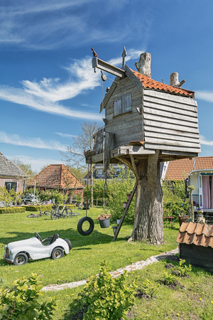 Treehouse in a garden in the village De Woude in The Netherlands