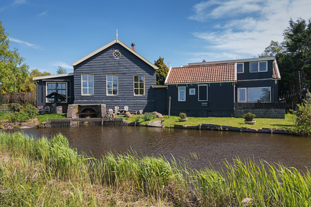 De Woude, Netherlands, April 30, 2017: Characteristic house iand also bucking n the village De Woude which is located on an island in the Alkmaarder and Uitgeester lake in The Netherlands Editorial