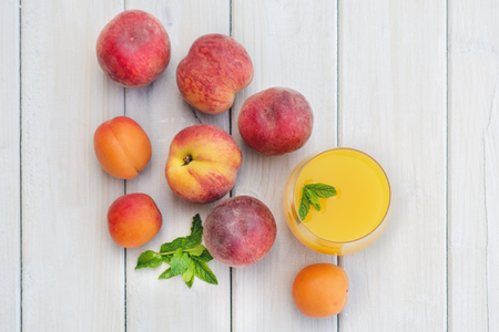 apricot kernels: Composition with apricots and nectarines  on a white table