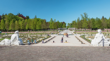 former: Apeldoorn, The Netherlands, May 8, 2016: Dutch baroque garden of The Loo Palace , a former royal palace and now a national museum located in the outskirts of Apeldoorn in the Netherlands