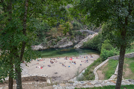 a bathing place: The Pont du Diable or Devil Bridge is a Roman bridge that spans the river Ardeche at about 10 m altitude. The bridge is located near the village of Thueyts in the Ardeche department in France