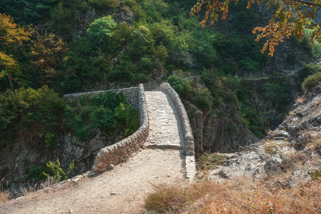 sooth: The Pont du Diable or Devil Bridge is a Roman bridge that spans the river Ardeche at about 10 m altitude. The bridge is located near the village of Thueyts in the Ardeche department in France