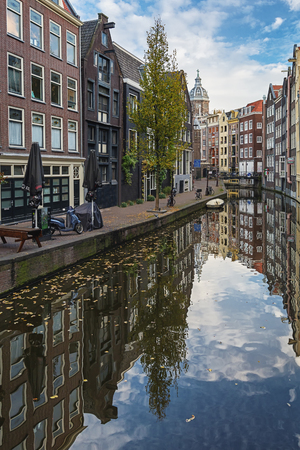Amsterdam, Netherlands - October 30, 2016: The canal houses along the junction of the canal Oudezijds Achterburgwal in the old center of Amsterdam Editorial