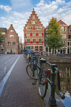 Amsterdam, Netherlands - October 30, 2016: Bicycles parked on a bridge across the canal Oudezijds Voorburgwal in the Red Light District in the old town of Amsterdam