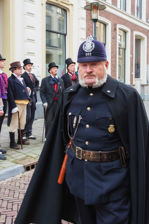 staging: Deventer, Netherlands - December 18, 2016: One of the characters from the famous books of Dickens during the Dickens Festival in Deventer, The Netherlands Editorial