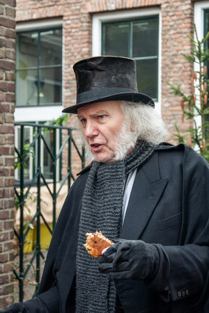 Deventer, Netherlands December 18, 2016: Scrooge one of the characters from the famous books of Dickens during the Dickens Festival in Deventer, The Netherlands Editorial