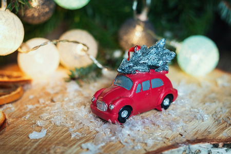 colourful lightings: Zaandam, Netherlands, January 8, 2017:  Small red car in front of a Christmas branch decorated with illuminated christmas balls Stock Photo