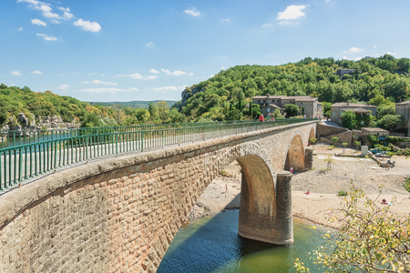 The bridge over the river Ardeche near the old village Balazuc which village is recognized as historical heritage and is considered as one of the charming villages of France