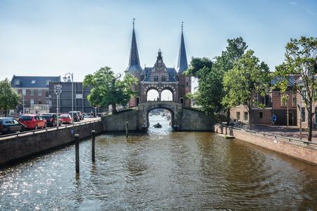 Sneek, Netherlands, 23 August 2015: De Sneeker Waterpoort is the symbol of the Frisian town of Sneek in the Netherlands