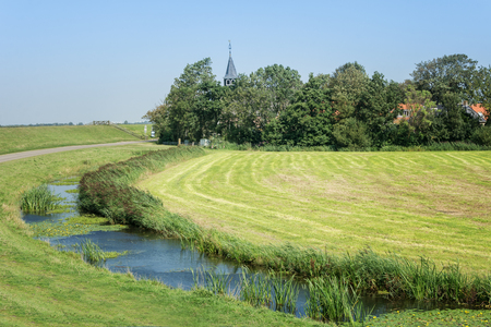 Church tower in a small village in the Frisian countryside in the Netherlands Stockfoto