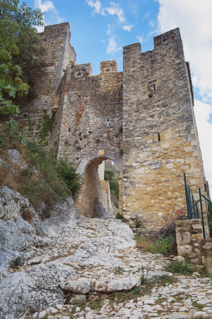 The remains of an old city wall of the village Saint Montan in the Ardeche region of France with the remains of an old city wall