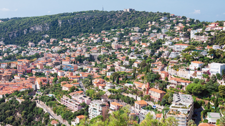 Impression of the city of Villefranche-sur-Mer located awith Fort du Mont Alban on top of the mountain in France